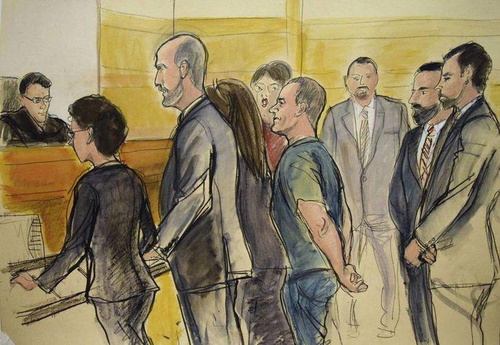 Joaquín 'El Chapo' Guzmán Loera (c), compareció ayer en un juzgado de Brooklyn para el inicio del juicio en su contra.  (Elizabeth Williams vía AP)