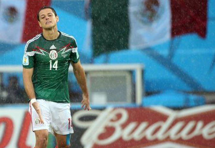 Muchos son lo rumores de la salida de Javier 'Chicharito' Hernández del ManU. En la imagen, el atacante mexicano durante su partipación en Brasil 2014 con la selección de México. (Notimex)