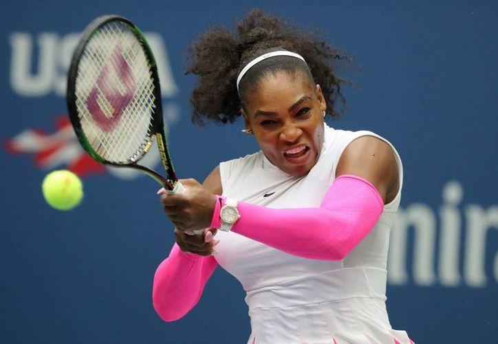 Serena Williams hizo historia con su victoria 308 en  torneos de Grand Slam, lo que la pone en cuartos de final del Abierto de EU. Rebasó un récord de Federer y Navratilova. (EFE)