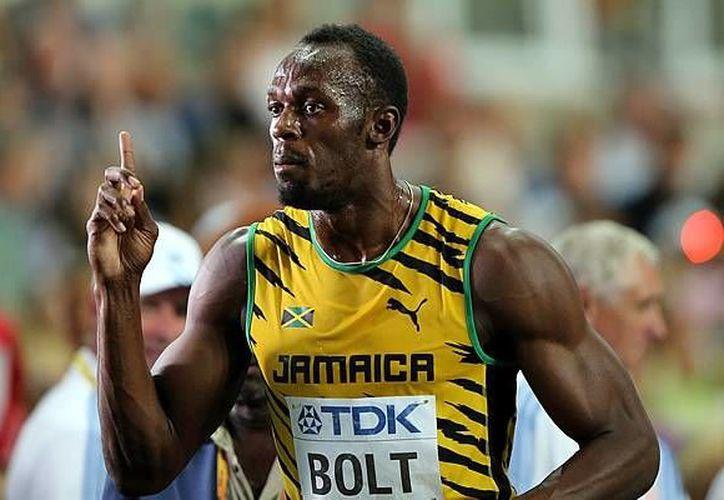 Usain Bolt, volverá a los Juegos del Aniversario de Londres el próximo verano, exactamente el 22 y 23 de julio. Esta actuación sería la última antes de que el jamaicano compita en los Juegos Olímpicos de Río de Janeiro. (AP)