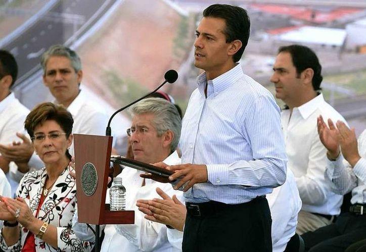 Peña Nieto subrayó que tres de siete millones de mexicanos que padecían hambre al inicio de su administración, tienen ahora resuelto ese problema. (Notimex/Foto de archivo)