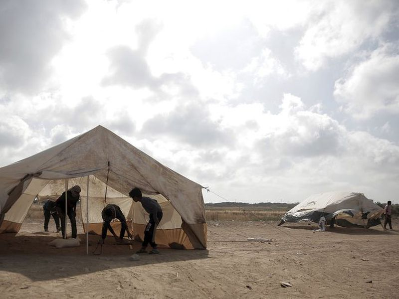 Palestinian protesters set up tents at the Gaza Strip's border with Israel. Palestinian activists are moving protest encampments closer to Israel's fence ahead of mass demonstration.
