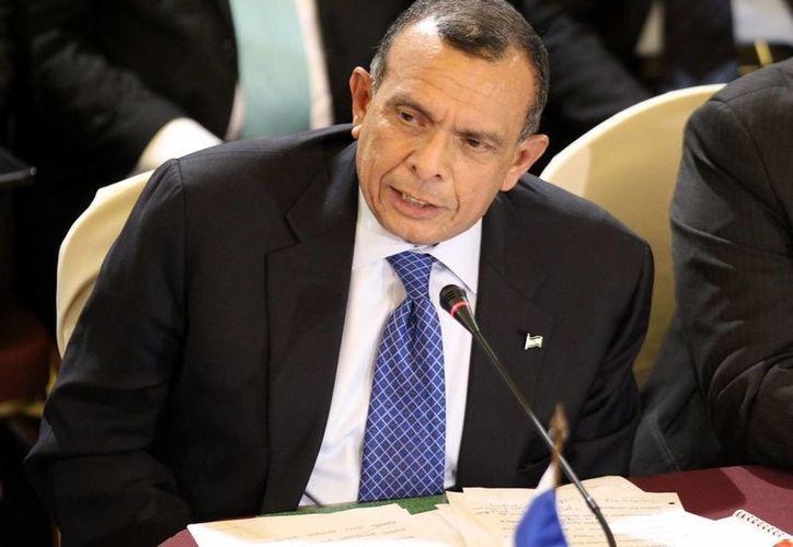 Porfirio Lobo además se pronunció a favor de que se cree una Policía Militar en Honduras. (EFE)