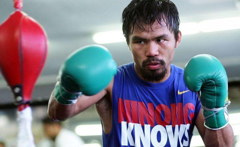 Manny Pacquiao confirmó hace unos días que las negociaciones van por buen camino y espera que pronto se cierre el contrato.(Archivo/AP)