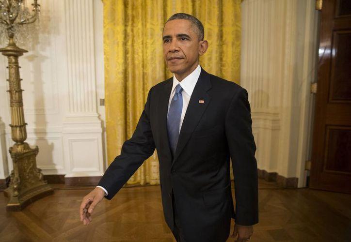 El presidente Obama anunciará una medida de alivio migratorio antes de que finalice el año, según divulgó la Casa Blanca. (AP)