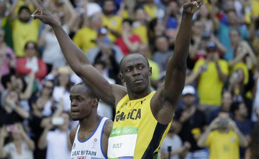 Usain Bolt buscará su pase el día de mañana, a la semifinales, para luego disputar las medallas de las disciplina. (Matt Dunham/AP)