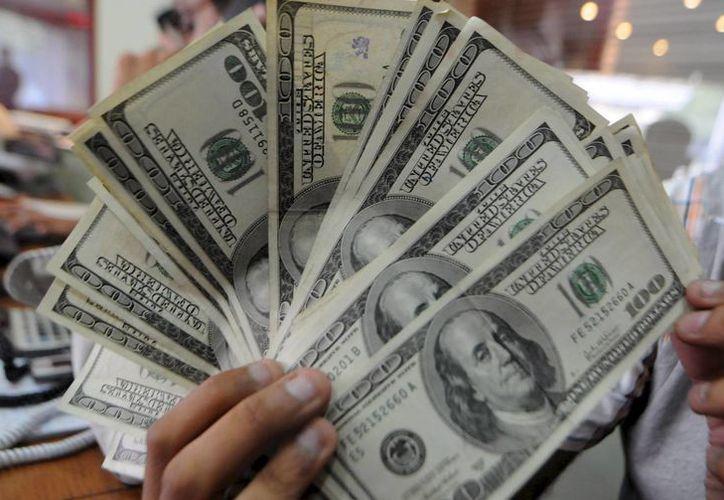 La lista es encabezada por el banco brasileño Itaú Unibanco, cuyos beneficios netos sumaron 7.620 millones de dólares el año pasado, escoltado por el también banco brasileño Bradesco. (Archivo/EFE)