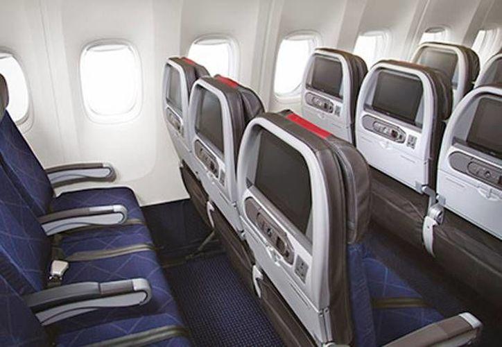 La firma American Airlines anunció que, a partir de noviembre de 2016, habrá un vuelo directo entre Miami, Florida y Mérida, Yucatán. La imagen, del interior de un avión de la aerolínea, está utilizada solo con fines ilustrativos. (aa.com)