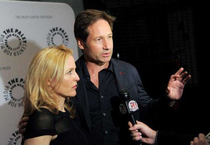 Los actores Gillian Anderson y David Duchovny en la mesa redonda 'The Truth Is Here: David Duchovny and Gillian Anderson on The X-Files'. (Agencias)