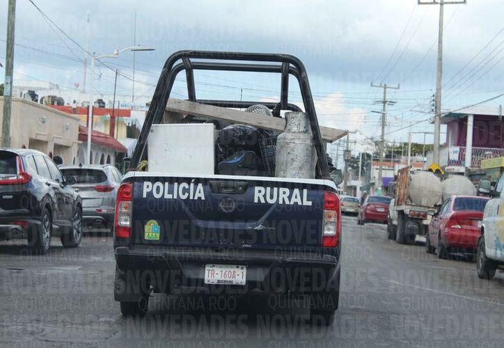 Realizan encuesta sobre las actividades de los elementos policíacos. (Joel Zamora/SIPSE)