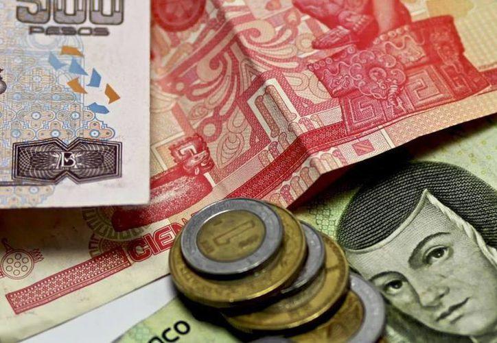 Hacienda dice que el ajuste en el crecimiento de 2016 se dará a conocer hasta que se presente el paquete económico del próximo año. (Agencias)