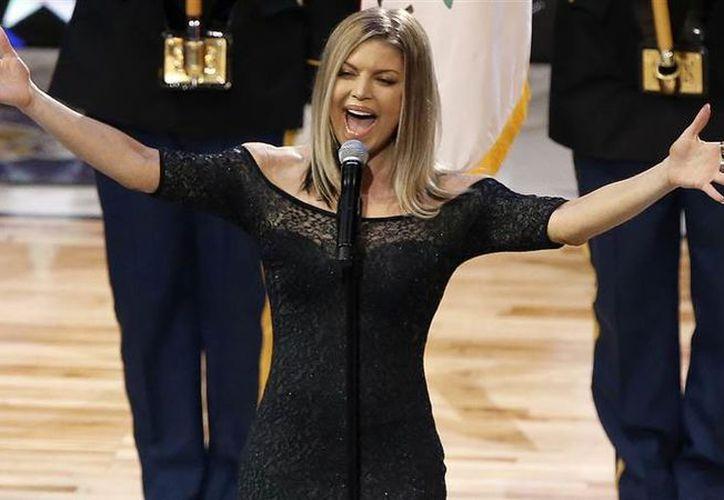 La cantante optó por interpretar su versión del himno de Estados Unidos en el partido All Star de la NBA. (Foto: Today)