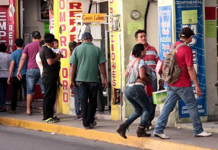Las casas de empeño están muy activas en este mes, por la cuesta de enero. Imagen de contexto de la zona donde se ubican varios negocios de este tipo, en el Centro histórico de Mérida. (Milenio Novedades)