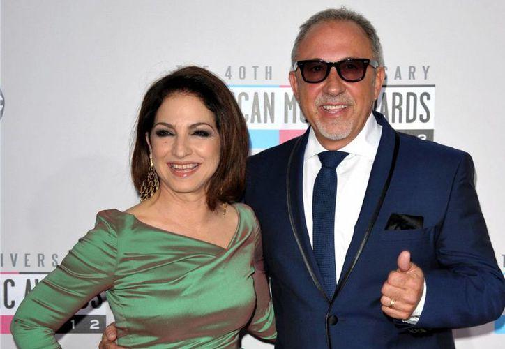 Emilio Estefan confesó que el documental sobre Marc A. Buoniconti se debe a una promesa que hizo cuando su esposa, Gloria Estefan (i), estuvo a punto de quedar paralítica hace 22 años. (Agencias)