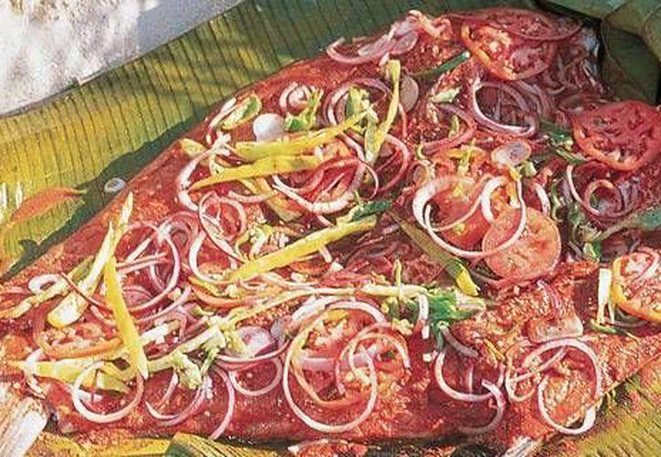En la receta del Tikin xic, el pescado es envuelto en hojas de plátano y se asa al carbón. (México Desconocido)