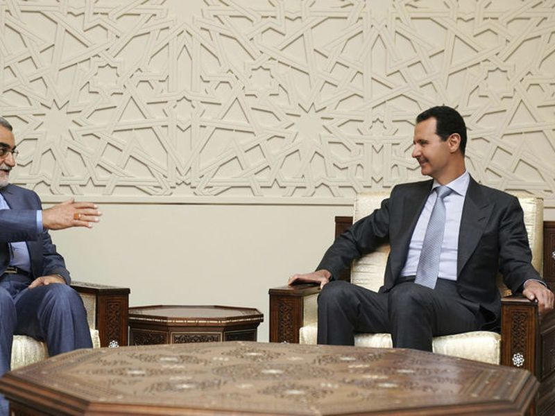 Syrian President Bashar Assad, right, meets with Alaeddin Boroujerdi, left, the head of Iran's parliamentary committee on national security and foreign policy, in Damascus, Syria.
