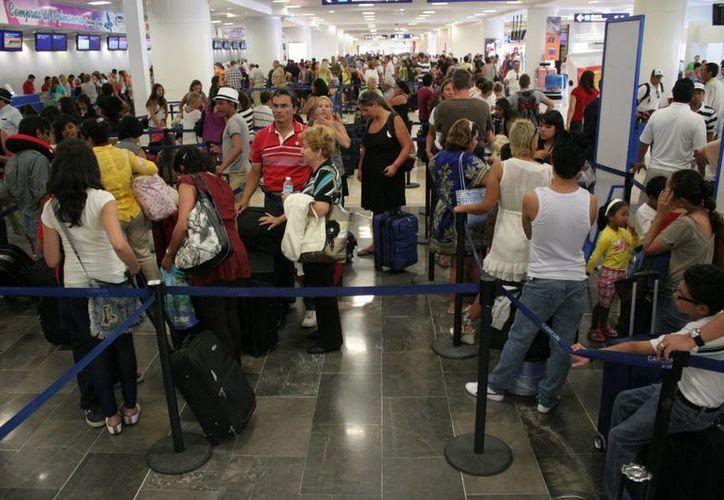 En lo que va del año, el Aeropuerto Internacional de Cancún ha roto en dos ocasiones su propio récord de operaciones en un día. (Redacción/SIPSE)