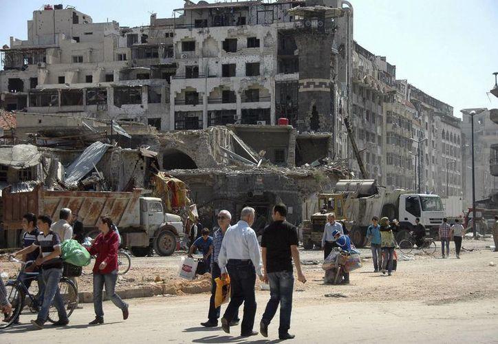 Además de los atentados, se registraron fuertes combates entre rebeldes y leales al régimen sirio. (EFE)