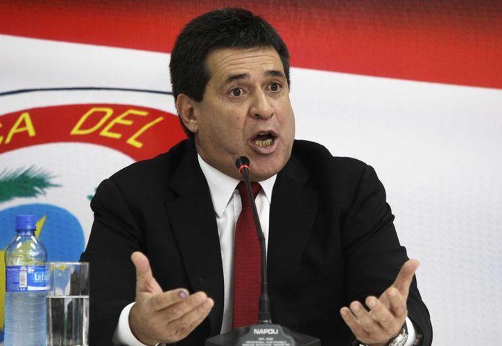 Horacio Cartes se dijo honrado que no existan denuncias de corrupción contra su gobierno. (AP/Archivo)