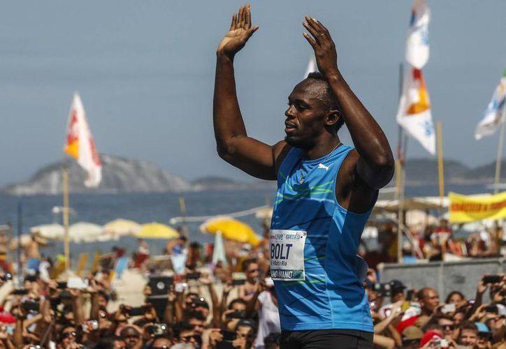En su primera carrera individual del año, el jamaiquino Ussain Bolt recorrió los 200 metros en 20.20 segundos. (EFE)