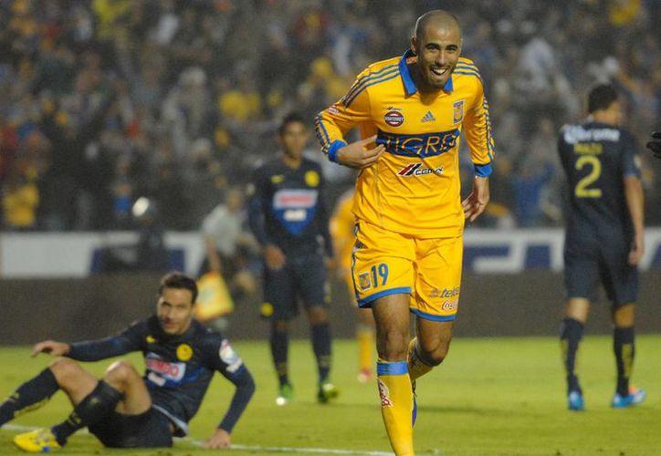 Los goles del encuentro fueron conseguidos por Alan Pulido y Guido Pizarro por Tigres y Juan Carlos Valenzuela y Aquivaldo Mosquera, por las Águilas. (Notimex)