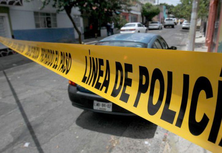 La madre asesinó a sus hijos de uno, 4 y 7 años, aparentemente agobiada por rencillas familiares. (AFP)