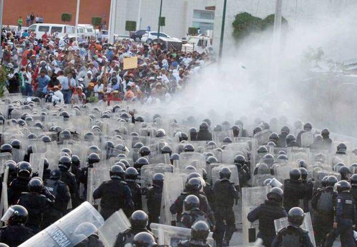Policías tuvieron que intervenir en algunas marchas, donde se suscitaron enfrentamientos. (Archivo SIPSE)