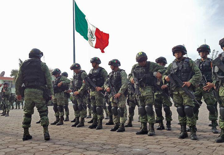 Los elementos llegaron ayer al Campo Militar de Cancún. (Jesús Tijerina/SIPSE)