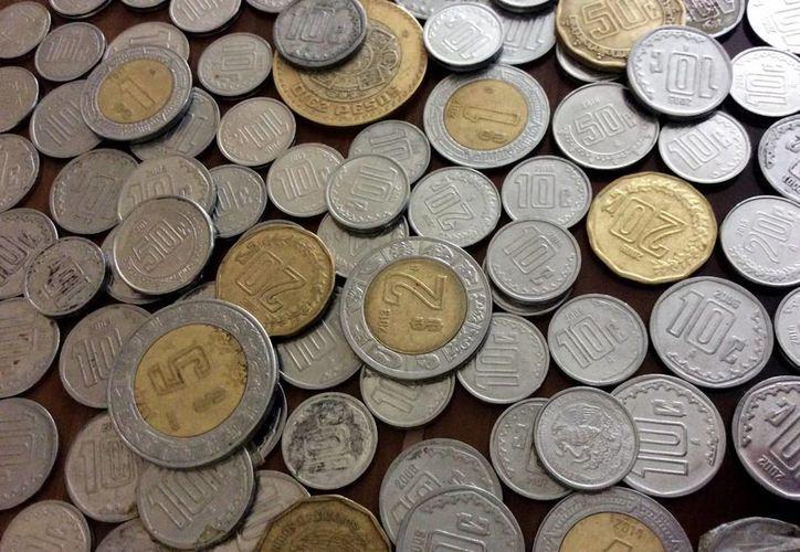 El Banco de México estima que por cada mexicano hay 264 monedas. (Notimex)