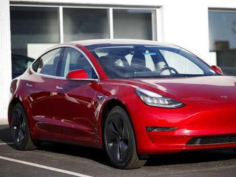 A 2018 Model 3 sedan sits at a Tesla dealership in Littleton, Colo.