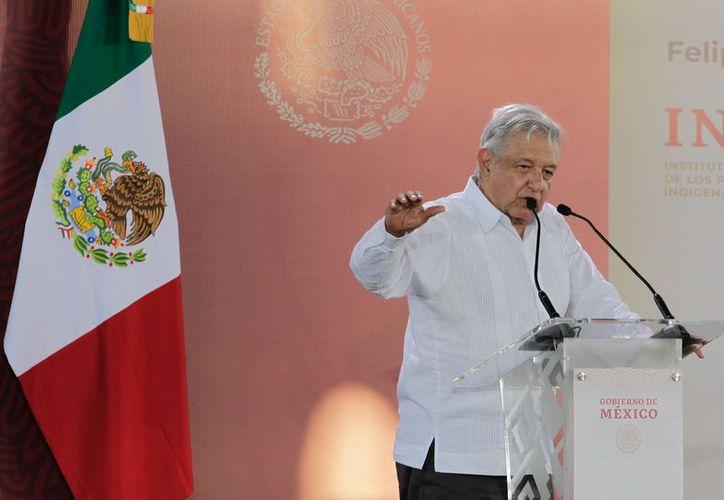 AMLO urgió a los pobladores a que apoyen el Tren Maya, pues impactará de forma positiva en el desarrollo de la economía de la región. (Notimex)