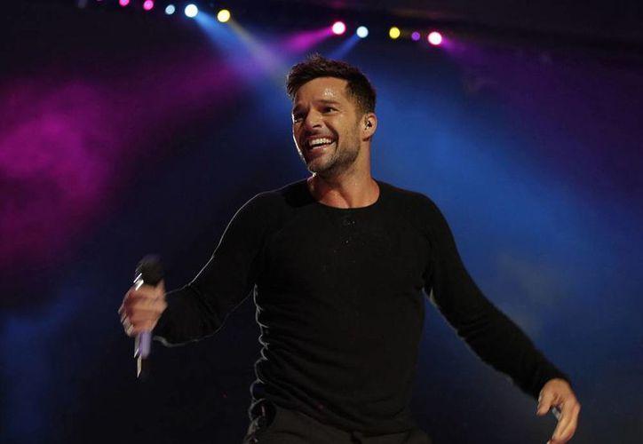 Ricky Martin no cantará la canción oficial de la Copa del Mundo, pero interpretará uno de los temas oficiales: <i>Vida</i>, mezcla de géneros pop y tropical. (Agencias)