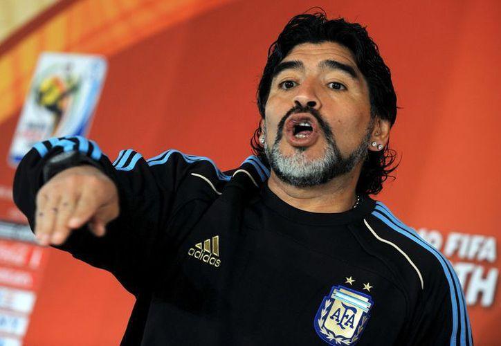 'Vamos a seguir este camino', dijo Maradona. (EFE)