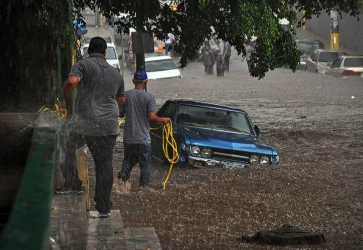 La temporada de lluvias en Honduras, que va de mayo a noviembre, ha dejado hasta ahora al menos doce muertos. (Agencias)