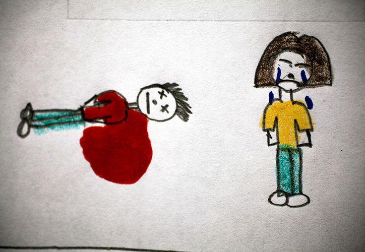 Los dibujos de estos niños ponen color a un presente violento, y hacen pensar en un futuro difícil y oscuro. (RT)
