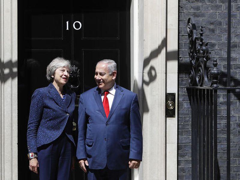Britain's Prime Minister Theresa May greets Israeli Prime Minister Benjamin Netanyahu in Downing Street, London. May and Netanyahu held talks inside 10 Downing Street.