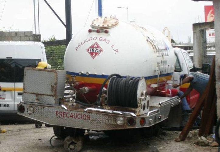 Empresas distribuidoras de gas LP estarán obligadas a aumentar las inversiones en operación, mantenimiento y capacitación. (Archivo/SIPSE)