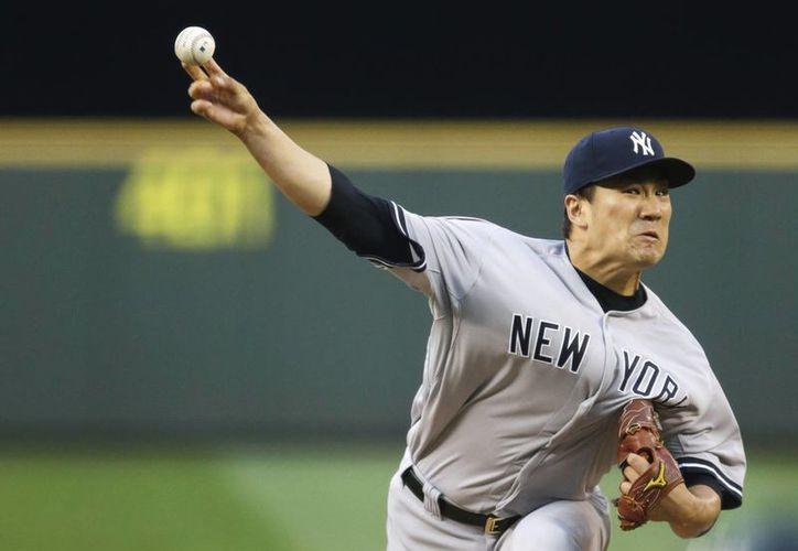 Tanaka se convirtió en el segundo lanzador en llegar a 10 triunfos y se llevó su cuarta victoria en fila. (Foto: AP)