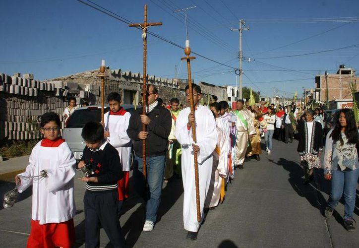 La celebración del Domingo de Ramos anticipa la crucifixión de Cristo. (Notimex)