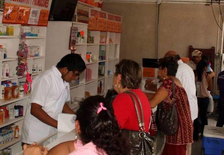 Las cinco farmacias sancionadas por la Profeco tras un operativo realizado al azar la semana pasada en Yucatán deberán afrontar multas porque reetiquetaban los medicamentos con precios más altos que lo marcado por el fabricante. (Milenio Novedades/Foto de archivo)