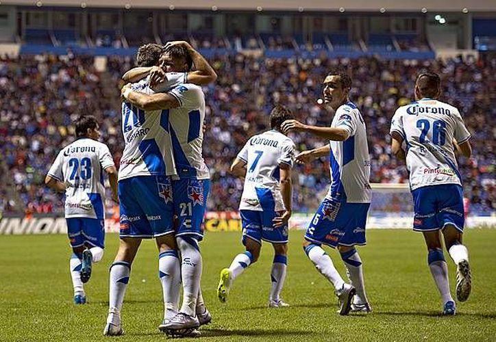 Con varios suplentes Puebla superó 4-1 al Atlas en la jornada 5 de la Liga MX. Y Morelia ganó a León. (mexsport.com)