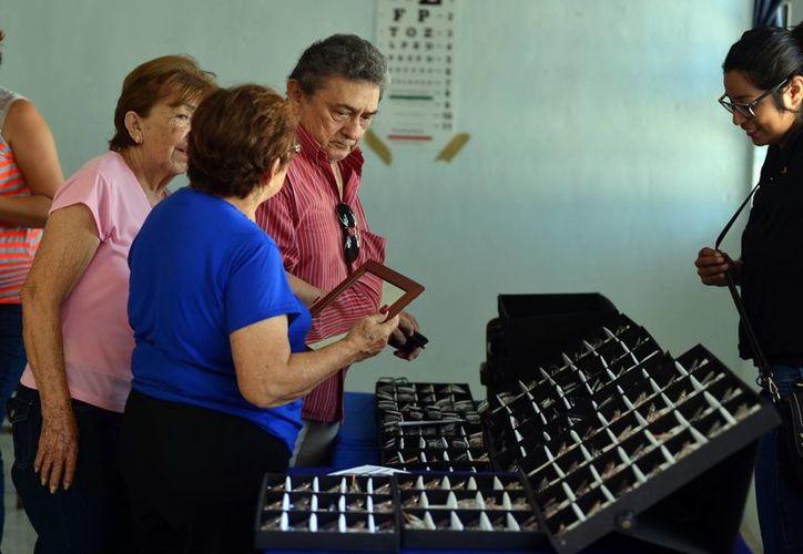 """El grupo apostólico Caballeros de Colón del Consejo 2109 """"Francisco de Montejo"""" proporcionan lentes a bajo costo, además de diversos servicios de salud. (Milenio Novedades)"""