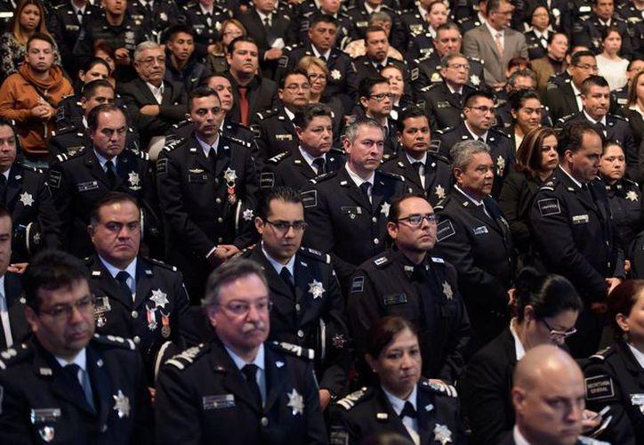 Peña Nieto dijo que los miembros de la Policía Federal, junto con el Ejército y la Armada, hacen una fuerza determinante en pro de la seguridad de la Nación. (Presidencia)