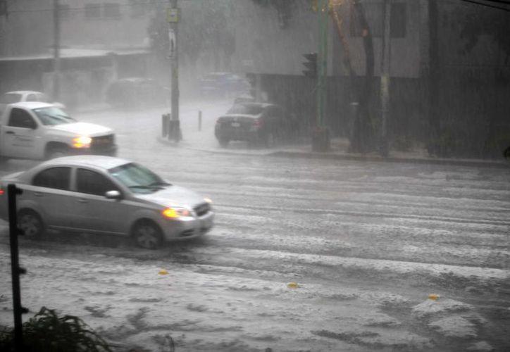 Las lluvias en Veracruz dejaron muertos, viviendas dañadas y poblados incomunicados. (Archivo/Notimex)