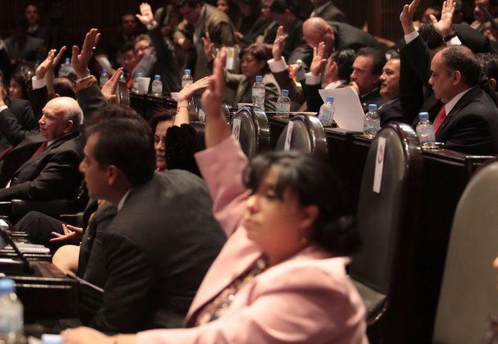 Los diputados federales acumularon hasta el 21 de diciembre pasado un rezago de 474 propuestas de reformas. (Archivo Notimex)