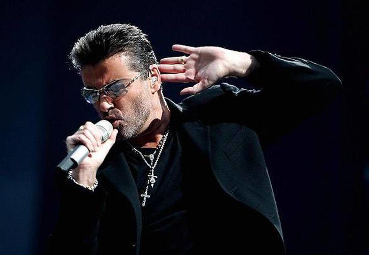 De acuerdo a su publicista,el cantante George Michael murió de manera tranquila en su casa. Por el momento no se ha dado a conocer la causa de su deceso.(Archivo/AP)