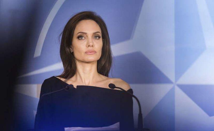Desde que anunciaron su divorcio en 2016, los actores se la han pasado en juzgados en una ardua batalla por la custodia de sus seis hijos. (Geert Vanden Wijngaert/AP)