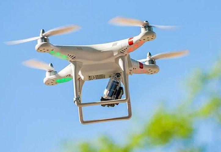 El usuario deberá especificar el uso que le dará al dron y en caso de requerir la aeronave no tripulada para fines científicos o colecta de información geográfica, tendrá que hacer un segundo registro ante el Inegi. Imagen de contexto de una aeronave no tripulada. (Archivo/Agencias)