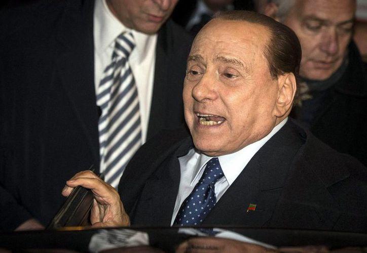 Silvio Berlusconi organizó una gran fiesta en su residencia en Roma, el Palacio Grazioli, para festejar su absolución del 'caso Ruby'. (EFE)