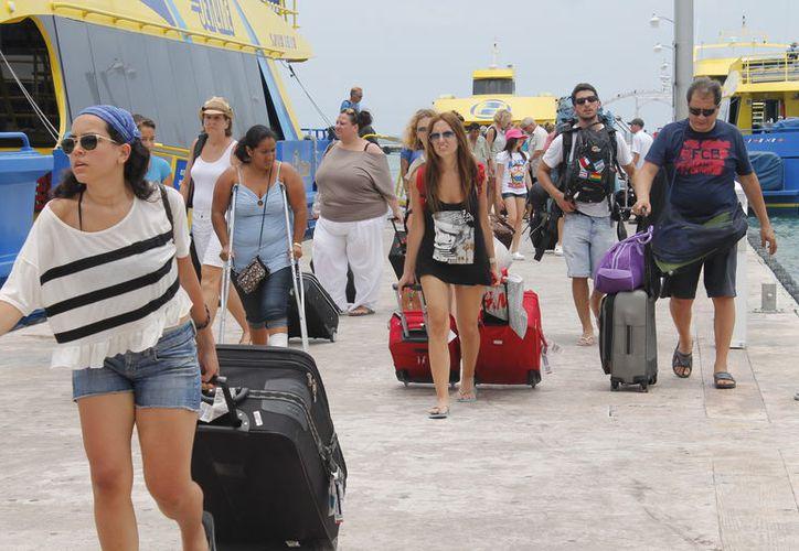 Las empresas marítimas Barcos Caribe, Barcos México y Ultramar, ofrecen sus servicios para los cruces de Playa del Carmen a Cozumel, y viceversa. (Foto: Israel Leal/SIPSE)